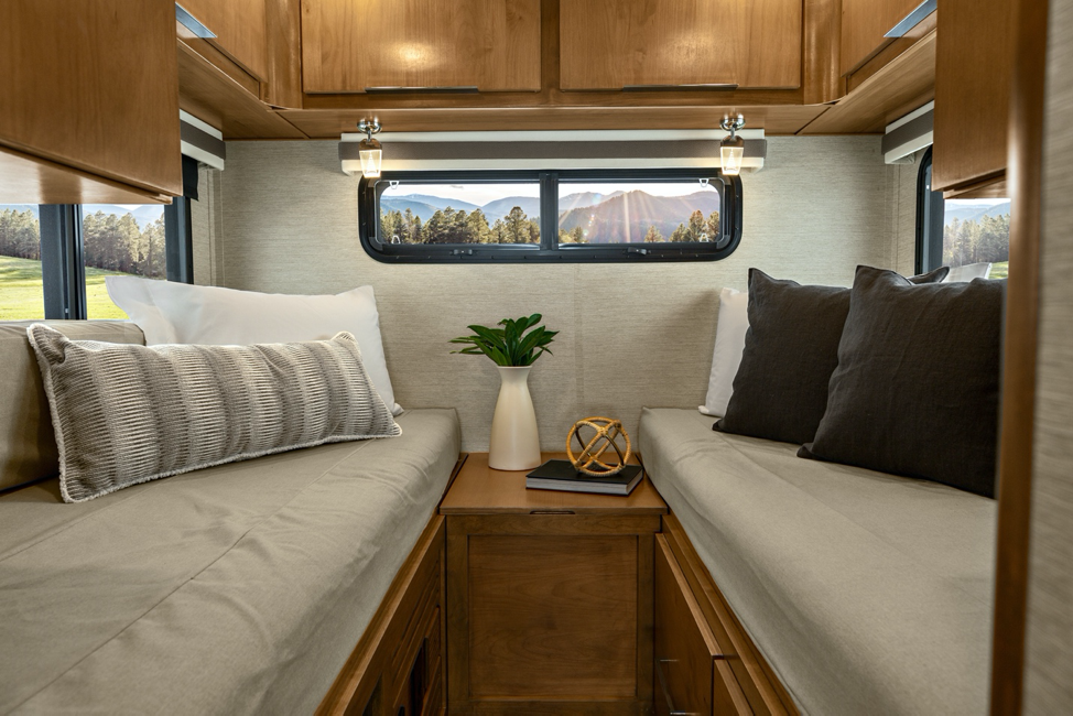 The interior of the Tiffin Wayfarer 24TW featuring two twin beds that combine to make a king-sized bed.