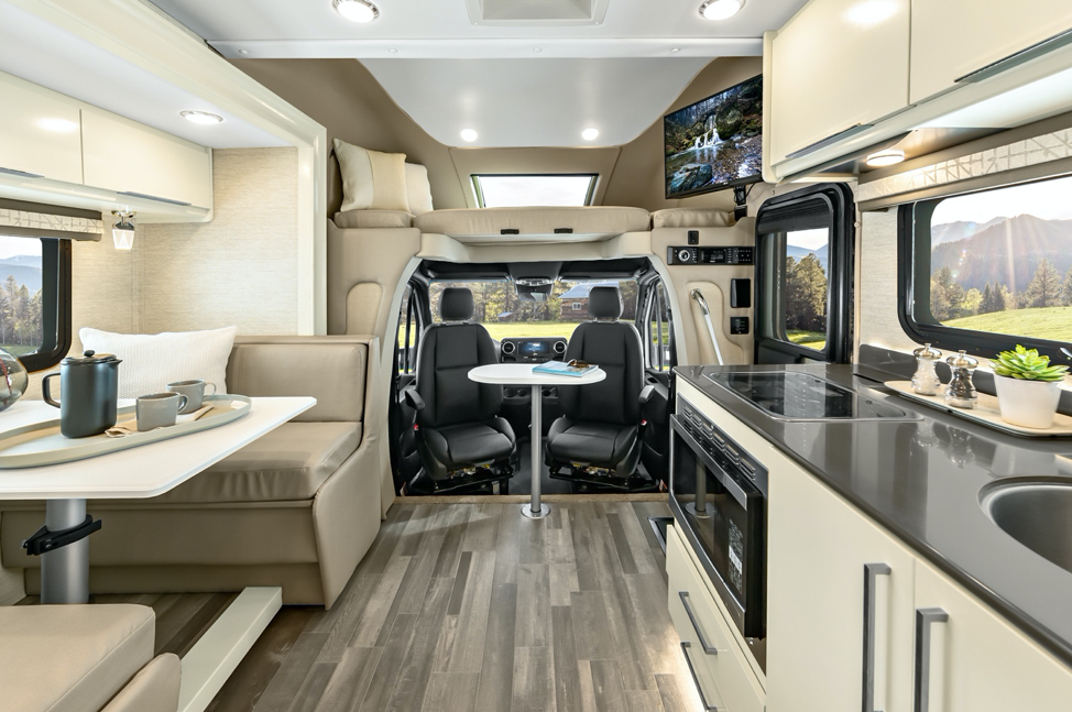 The 2020 Tiffin Wayfarer featuring linen cabinets, white sand leather and fully pivotal front seats.