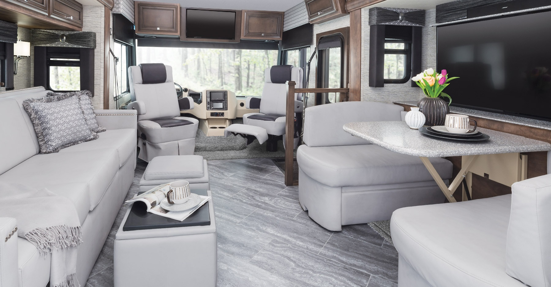 Six 2019 motorhomes, including Tiffin Open Road Allegro, Newmar Bay Star, Coachmen Leprechaun, Winnebago Fuse, Pleasure-Way Lexor TS, Midwest Automotive Designs Weekender