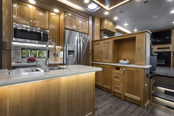 rv kitchen with full fridge