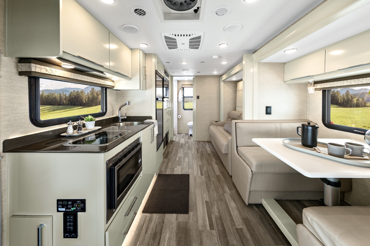 The interior of the 2020 Tiffin Wayfarer featuring a dinette and murphy bed.