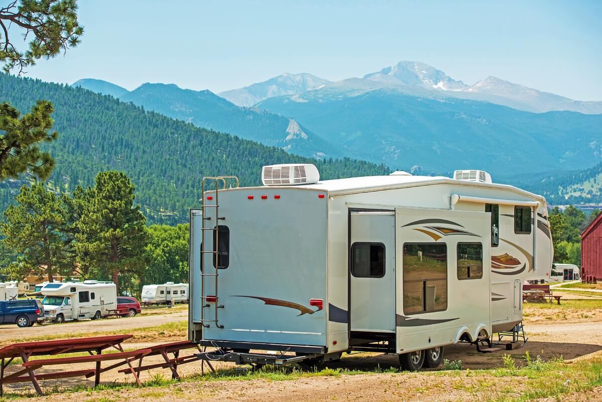 5th Wheel parked with mountain view