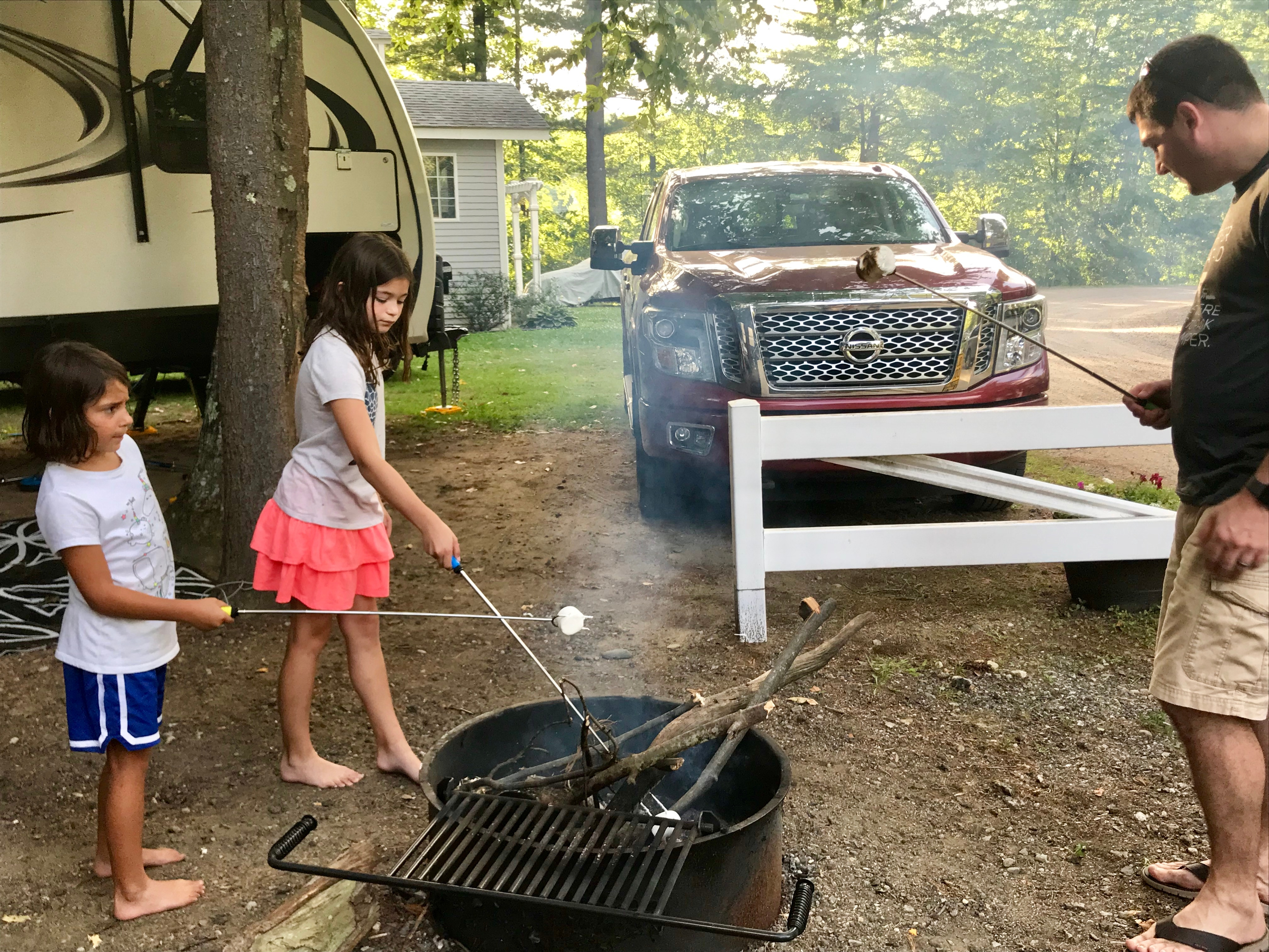 Campers Inn RV COO Ben Hirsch roasts marshmallows with his daughters