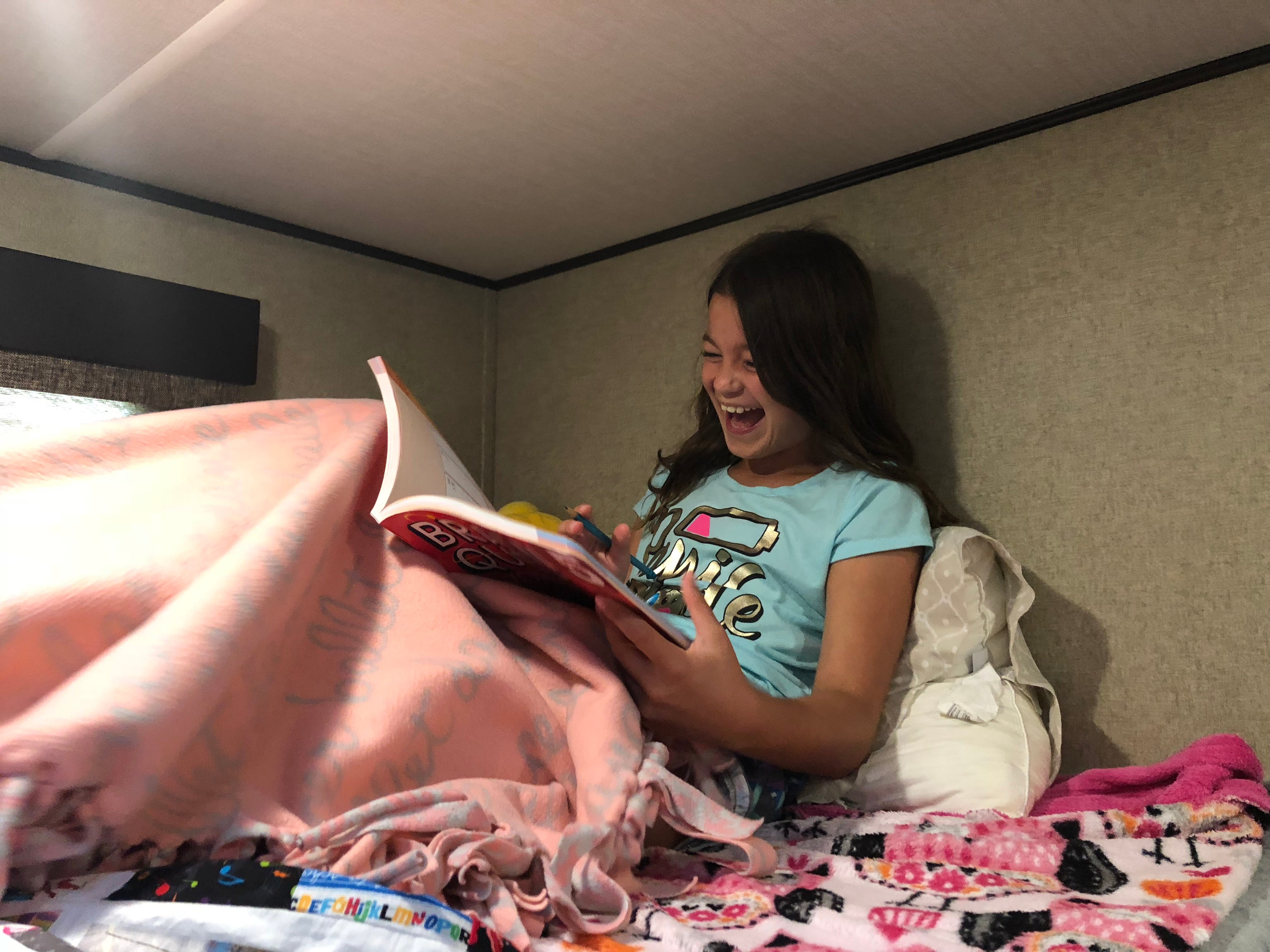 Reading in an RV bunkhouse