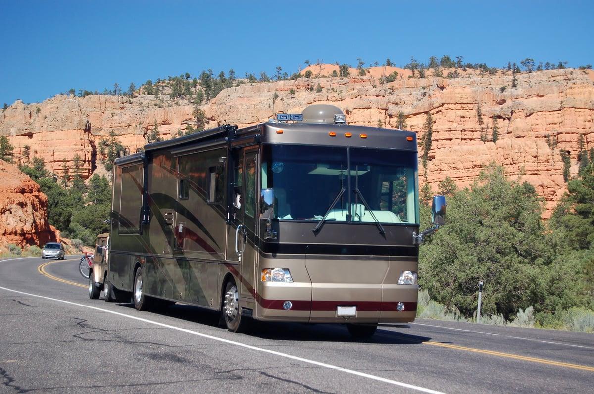 Motorhome driving along mountains