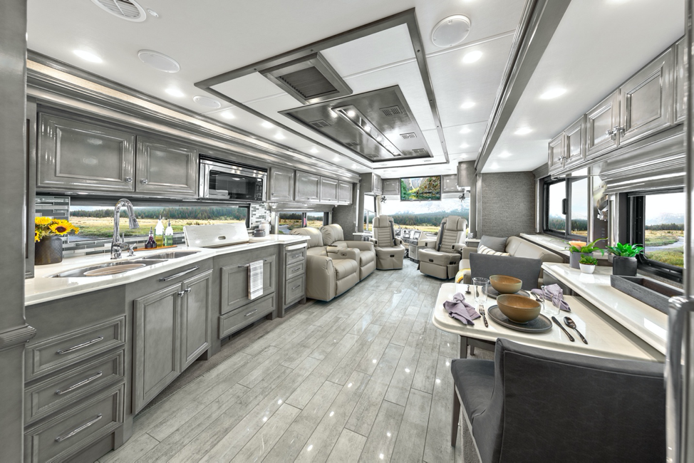 The interior of the 2020 Tiffin Phaeton featuring sterling cabinets and coastal sand décor.
