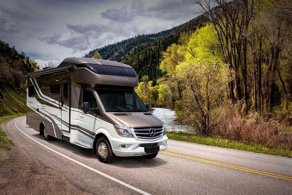 The exterior of the 2020 Tiffin Wayfarer driving on winding roads.