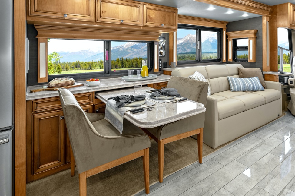 The dining area of the 2020 Tiffin Phaeton featuring a dinette.