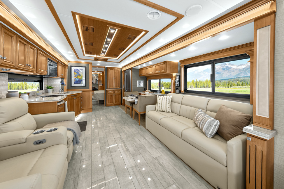 The living room of the 2020 Tiffin Phaeton featuring two recliner theater seats.