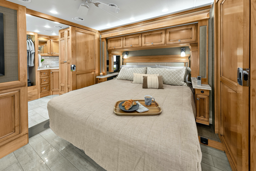 The interior of the 2020 Tiffin Phaeton, featuring a master bedroom with a king bed