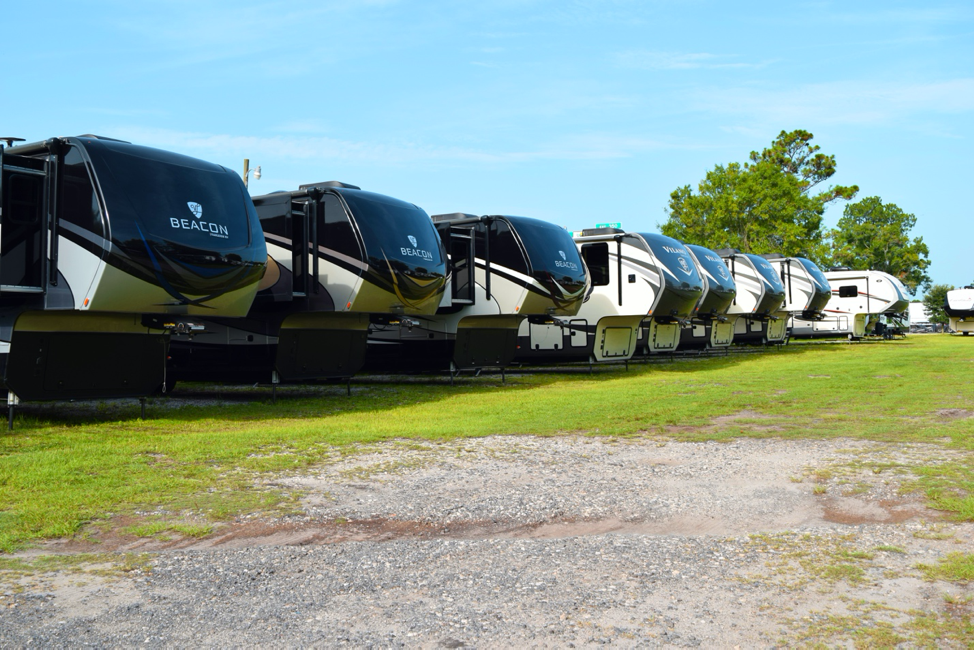 A line up of Van Leigh Beacon fifth wheels at Campers Inn RV of Jacksonville.