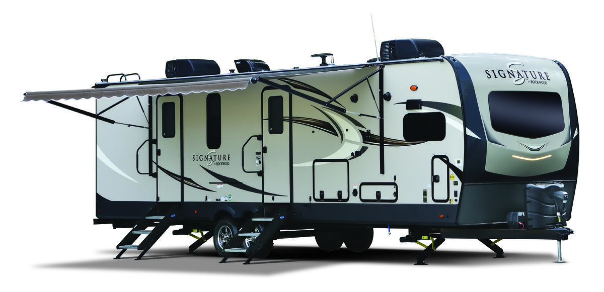 The exterior of the 2020 Rockwood Signature Ultra Lite travel trailer featuring double entry doors and a retractable awning.