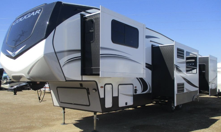 The exterior of the 2020 Keystone RV Cougar fifth wheel 367FLS features 4 slides and a 20-foot-long awning.
