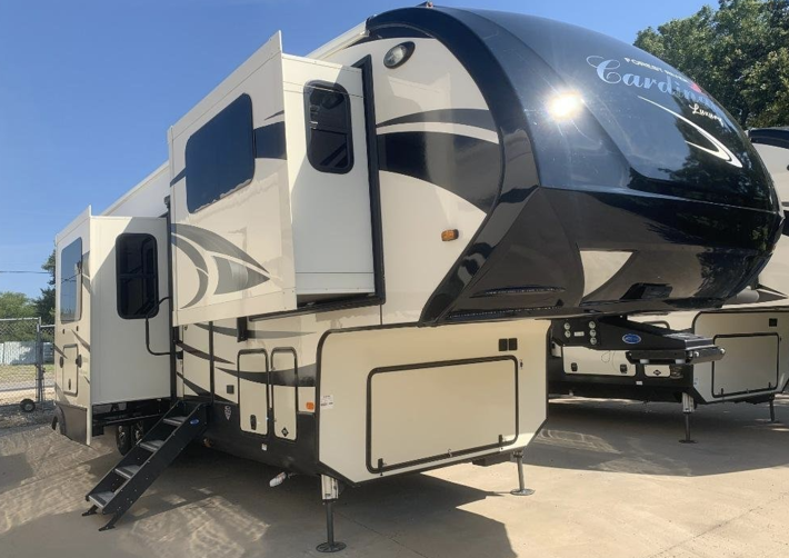 The exterior of the 2020 Forest River Cardinal Luxury 3700FLX fifth wheel featuring five slideouts and a height of over 13 ft.