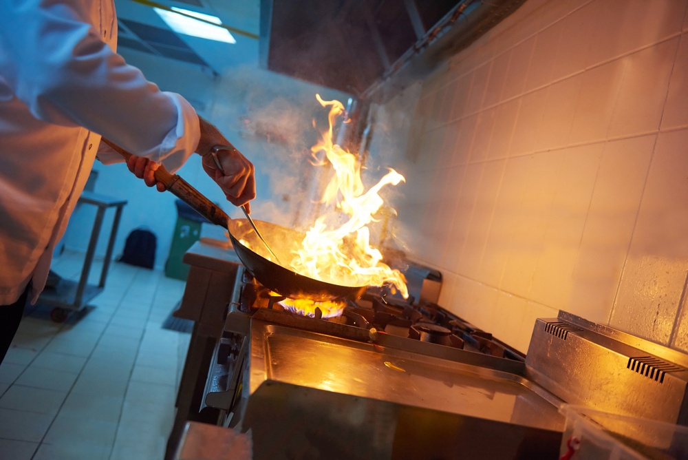 chef in hotel kitchen prepare vegetable  food with fire.jpeg