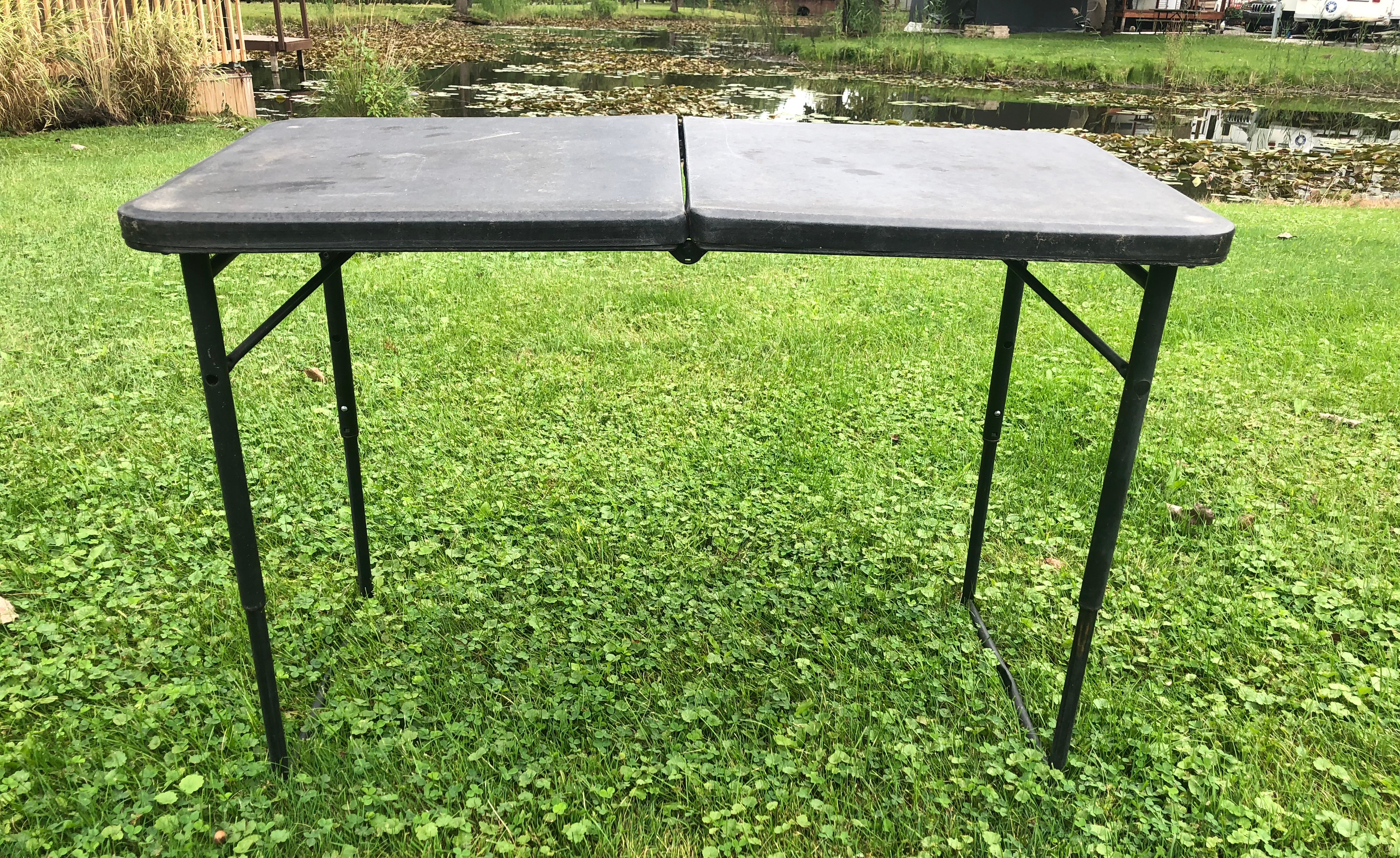 Use folding tables for cooking and eating outdoors at the campground
