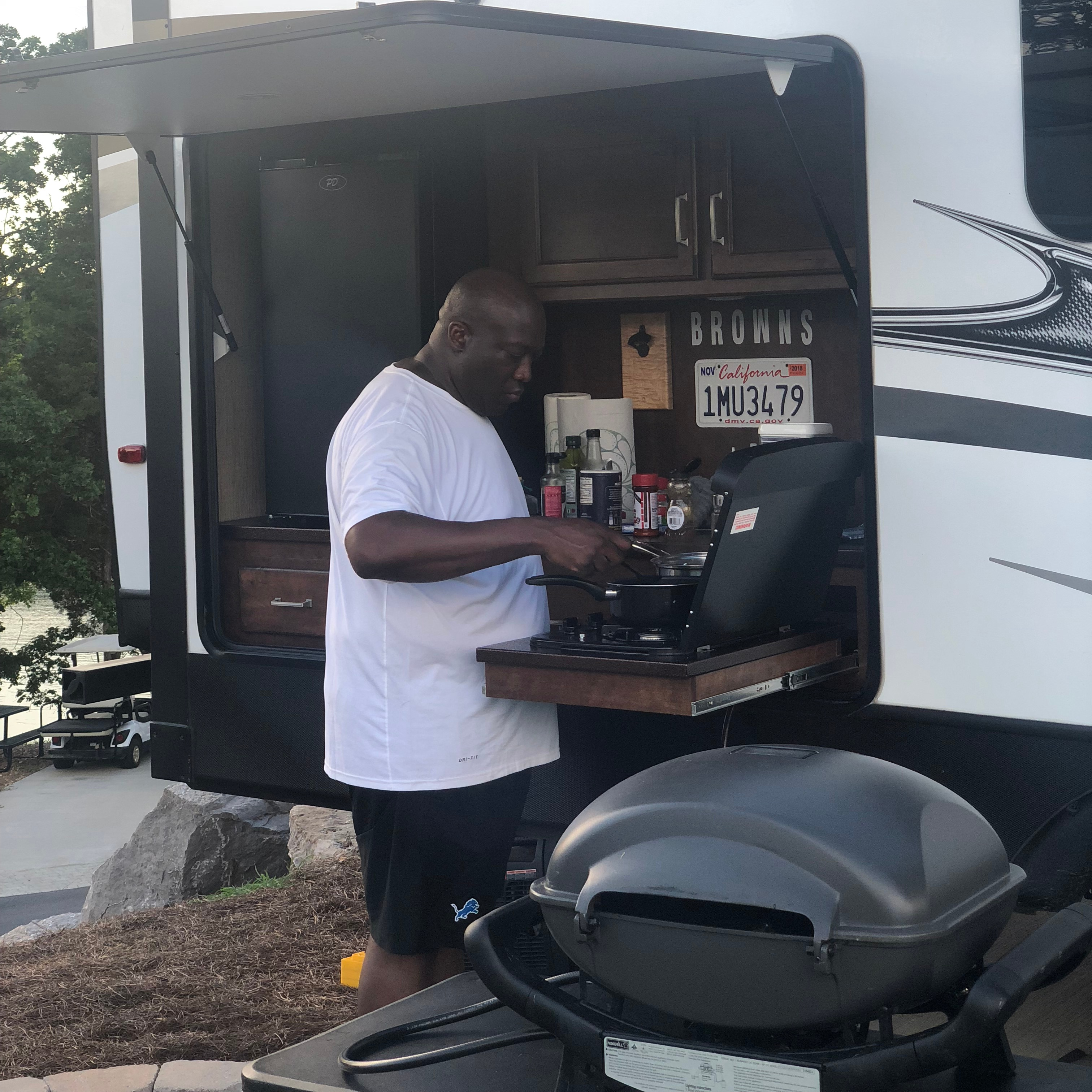 RVers love cooking in their outdoor kitchen when at the campground