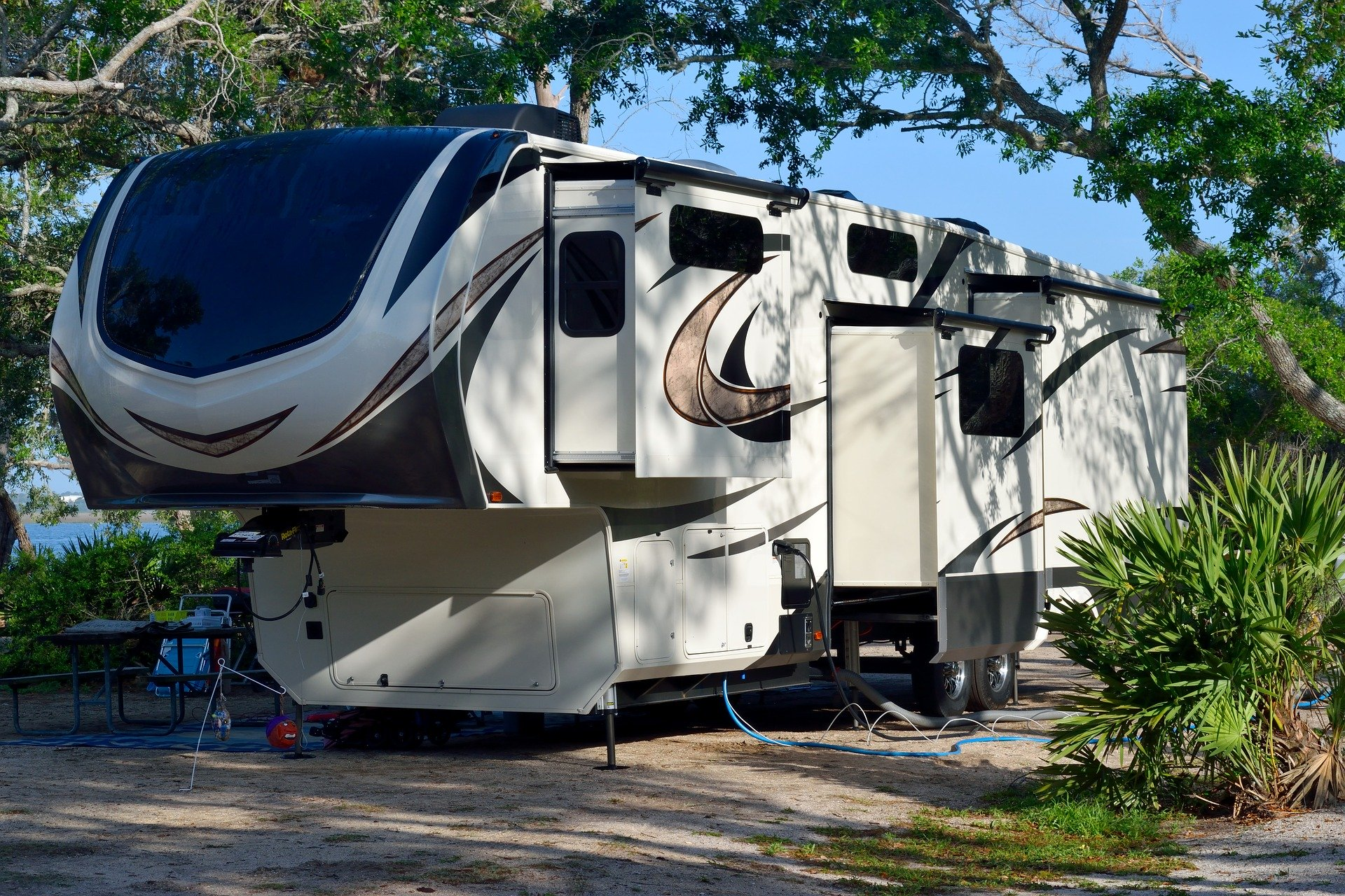 a fifth wheel trailer set up at a campsite