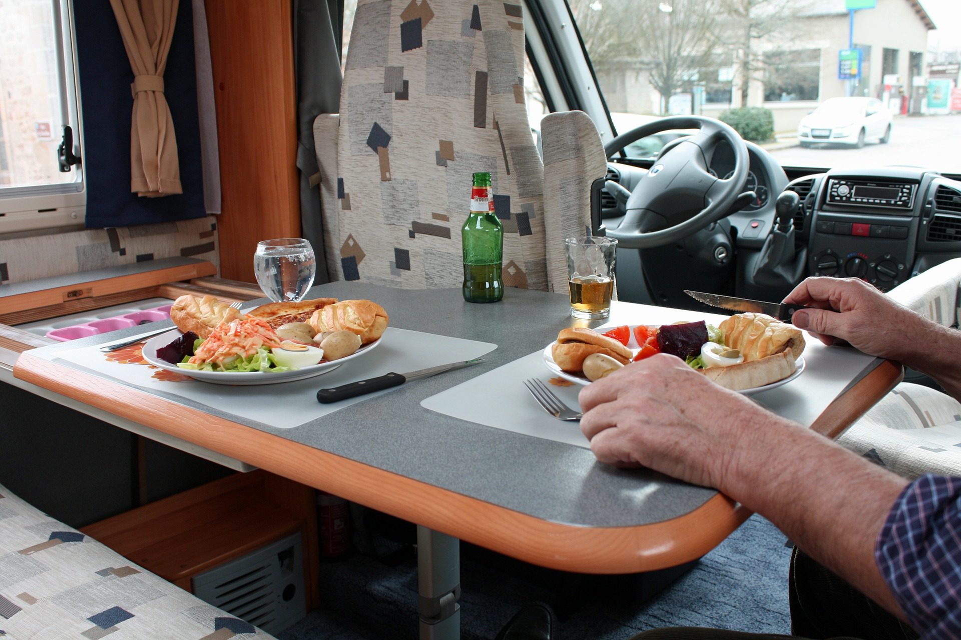 a meal set up in the interior of an rv