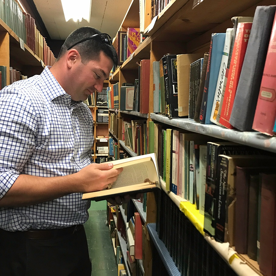 Campers Inn RV COO Ben Hirsch reads a book at a diner/bookstore in Connecticut