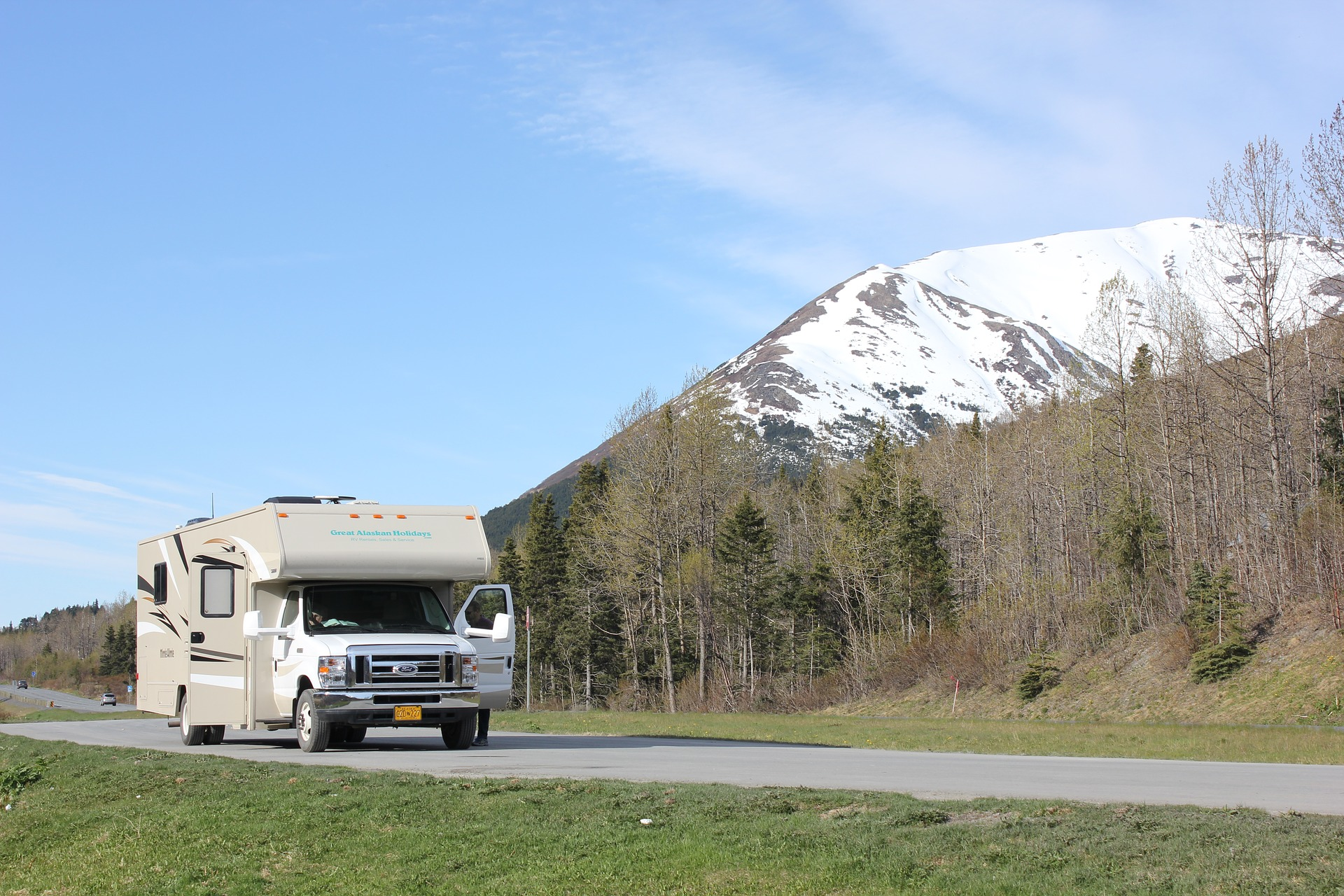 class c motorhome driving past mountains