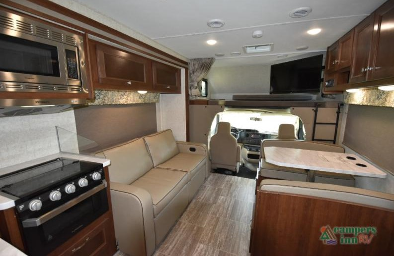 Living and eating space of the Forester Class C motorhome