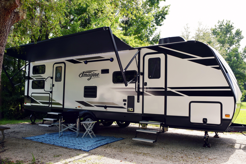grand design travel trailer imagine set up at a campsite