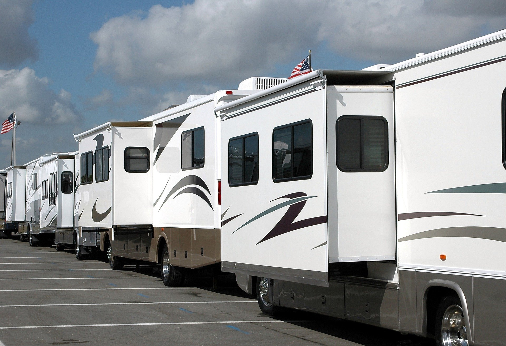 line up of rvs with slide out