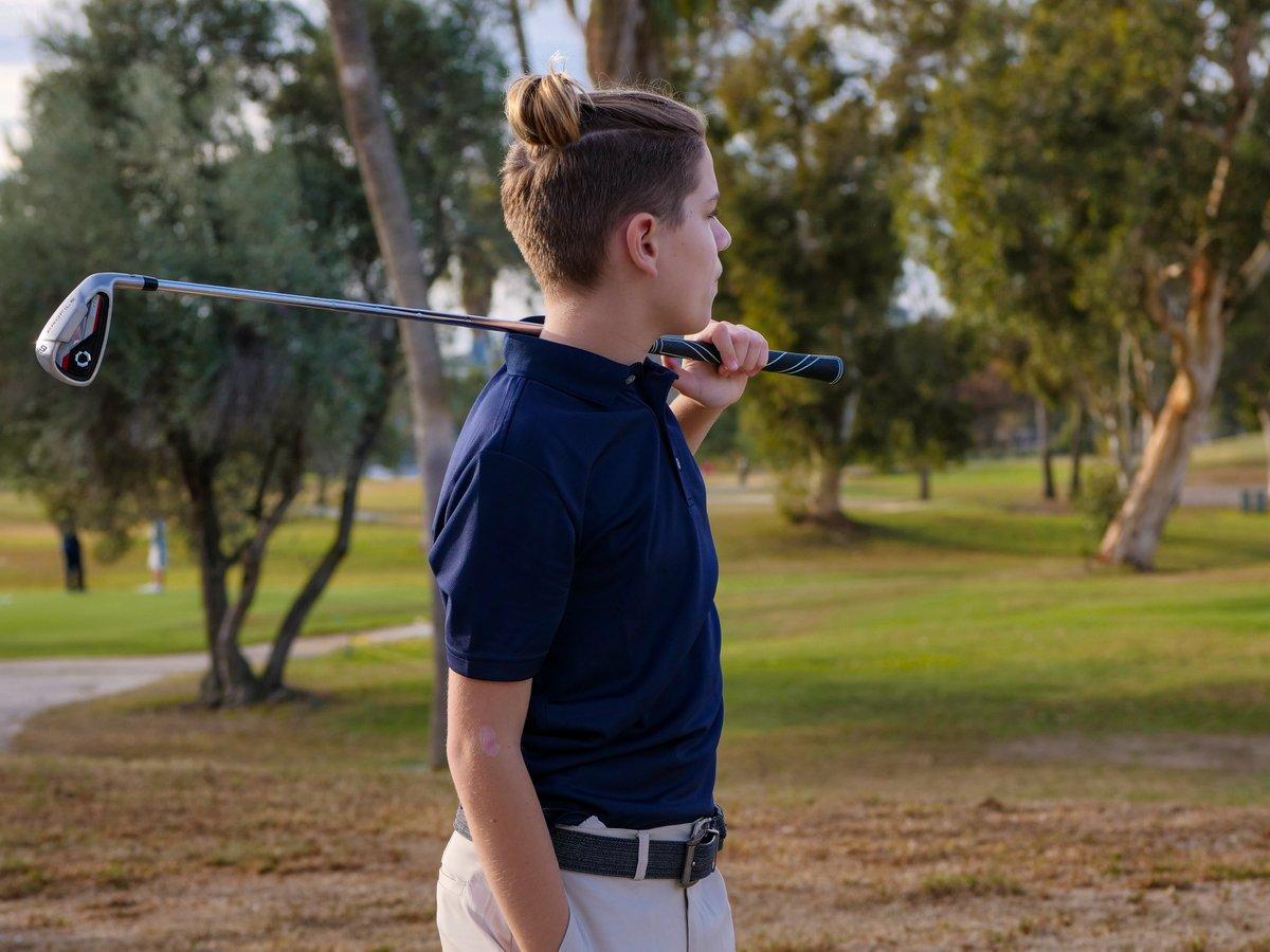 Young Boy Golfing