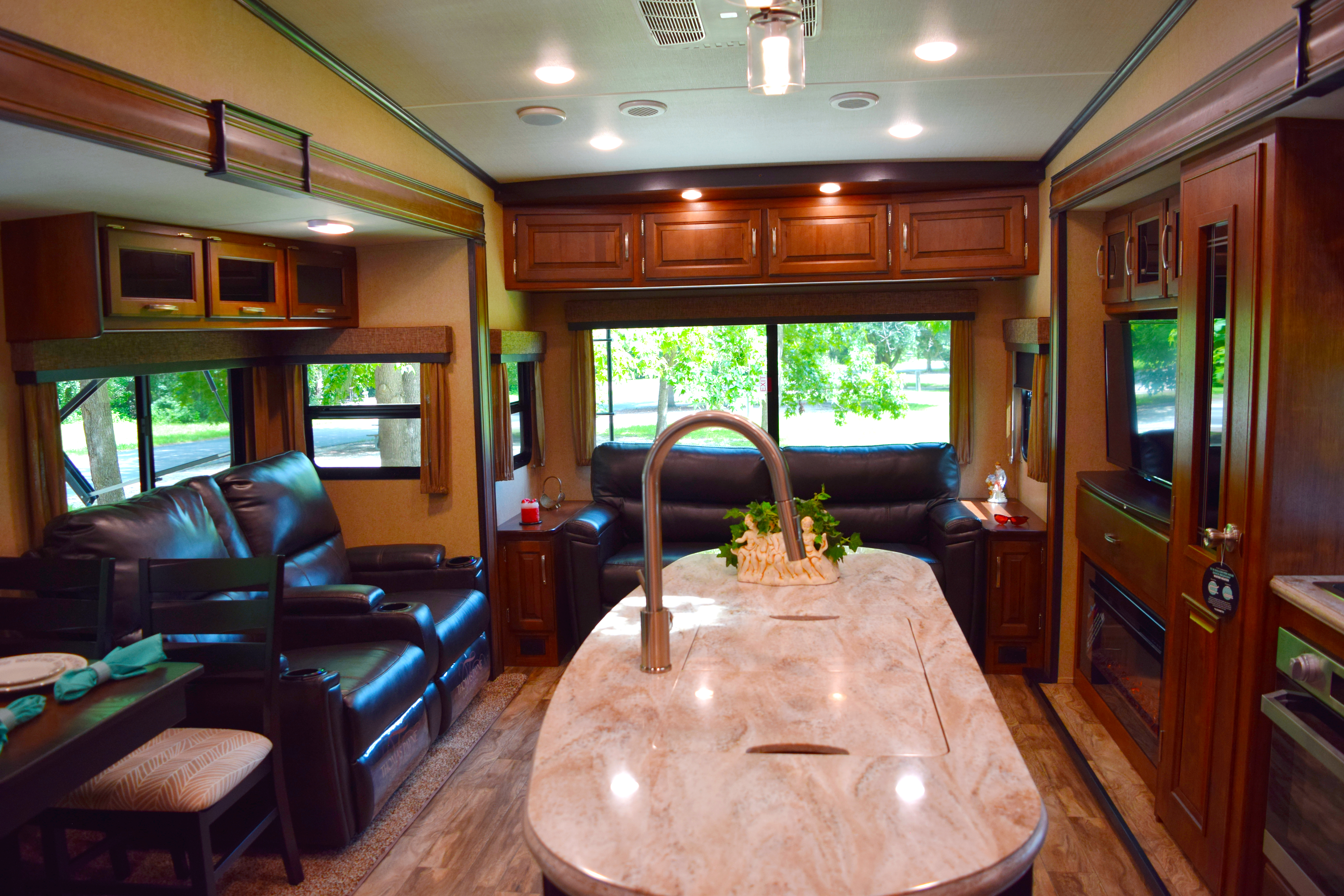 grand design reflection fifth wheel common area with fireplace and entertainment center