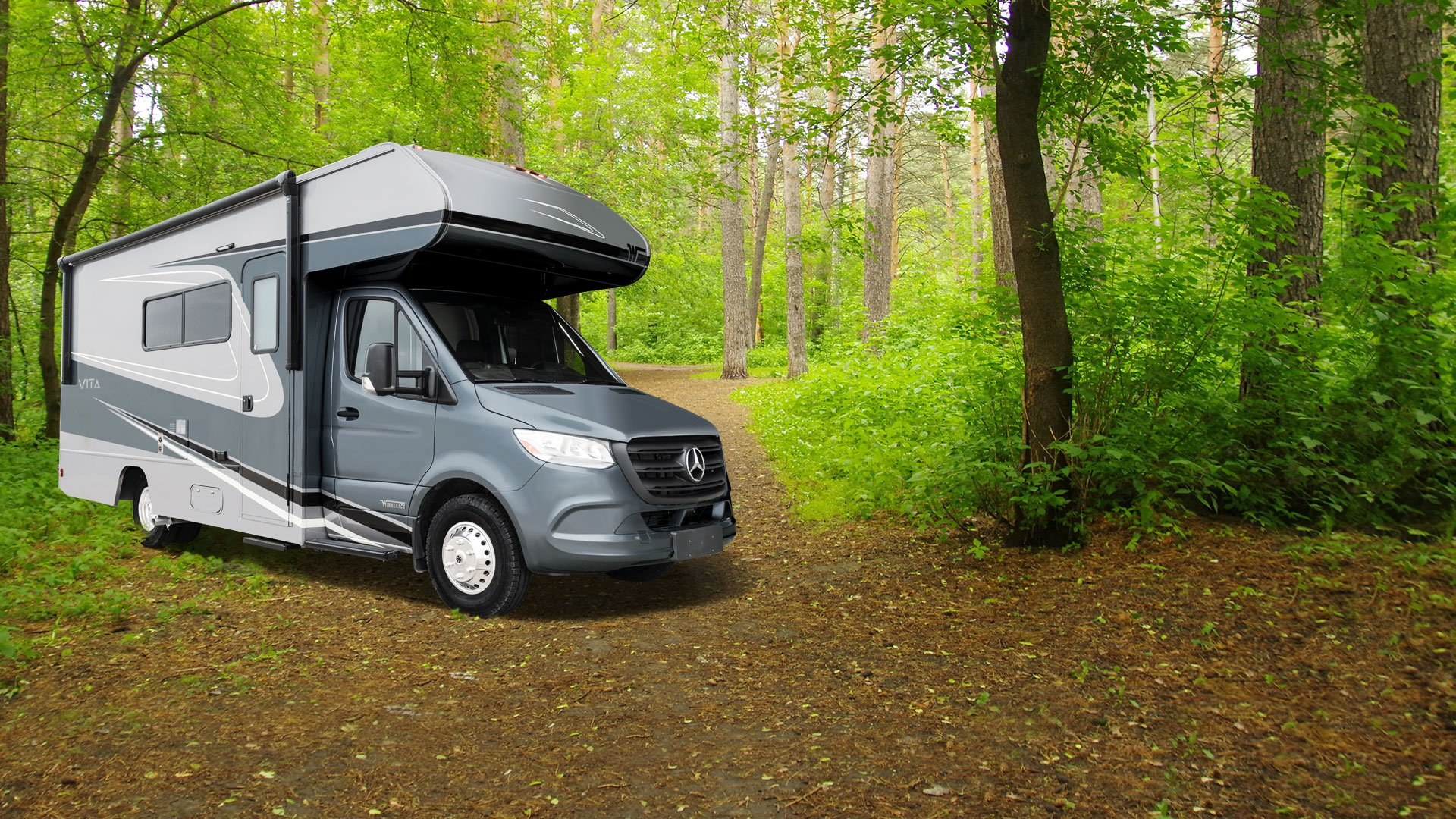 winnebago vita class c motorhome parked in the forest