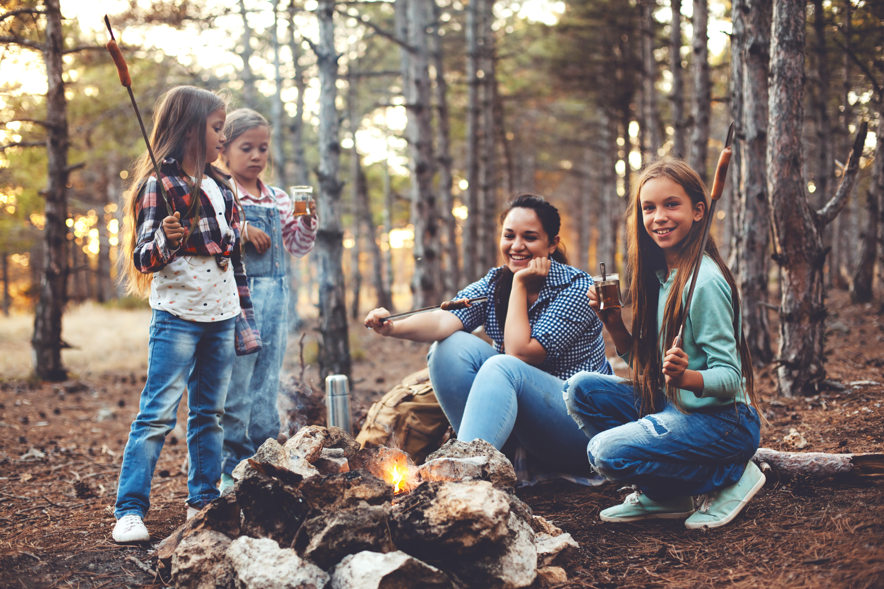 Cooking over campfire AdobeStock_116521196-1
